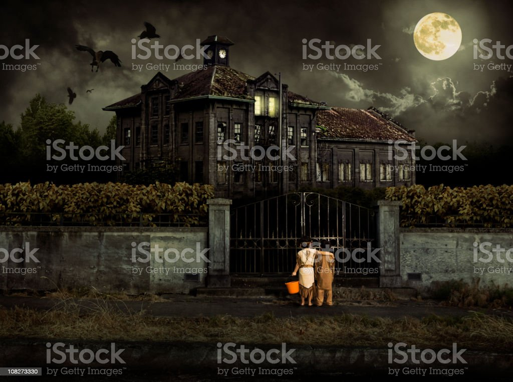 Costumed Kids Trick or Treat at Halloween Haunted House stock photo