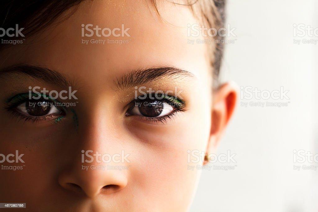 Costumed  Little Girl's Eyes for Brazilian Carnival stock photo