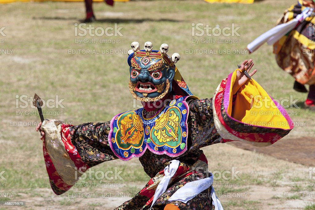 Costumed monk performs traditional dance at Festival of Wangdi. stock photo