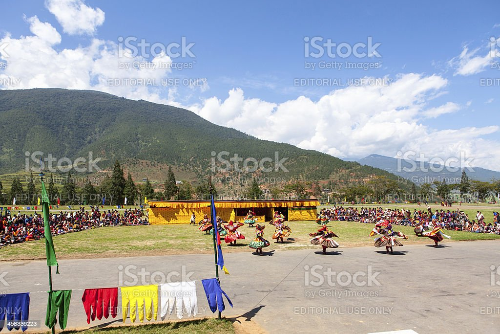Costumed monks perform traditional dance at Festival of Wangdi. stock photo