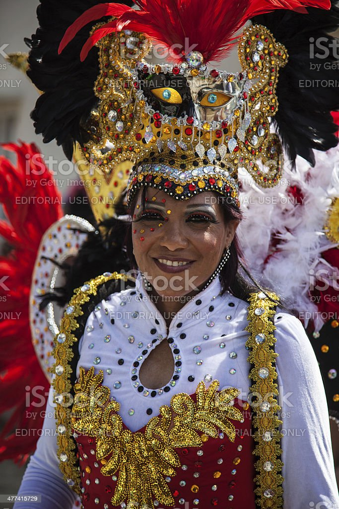 Costumed Woman Participates In Carnival Parade in Bonaire stock photo