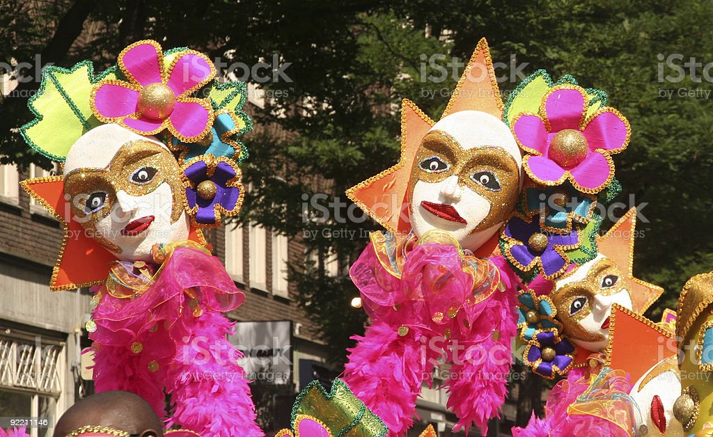 Costumes at a vibrant colored carnival stock photo
