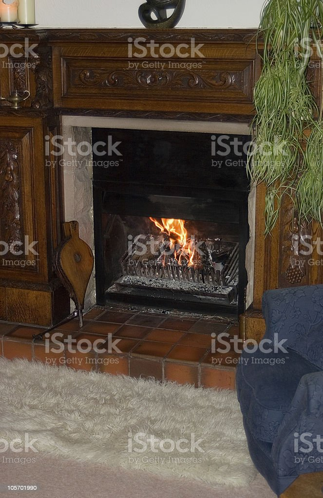 Cosy Chair by the Fire stock photo