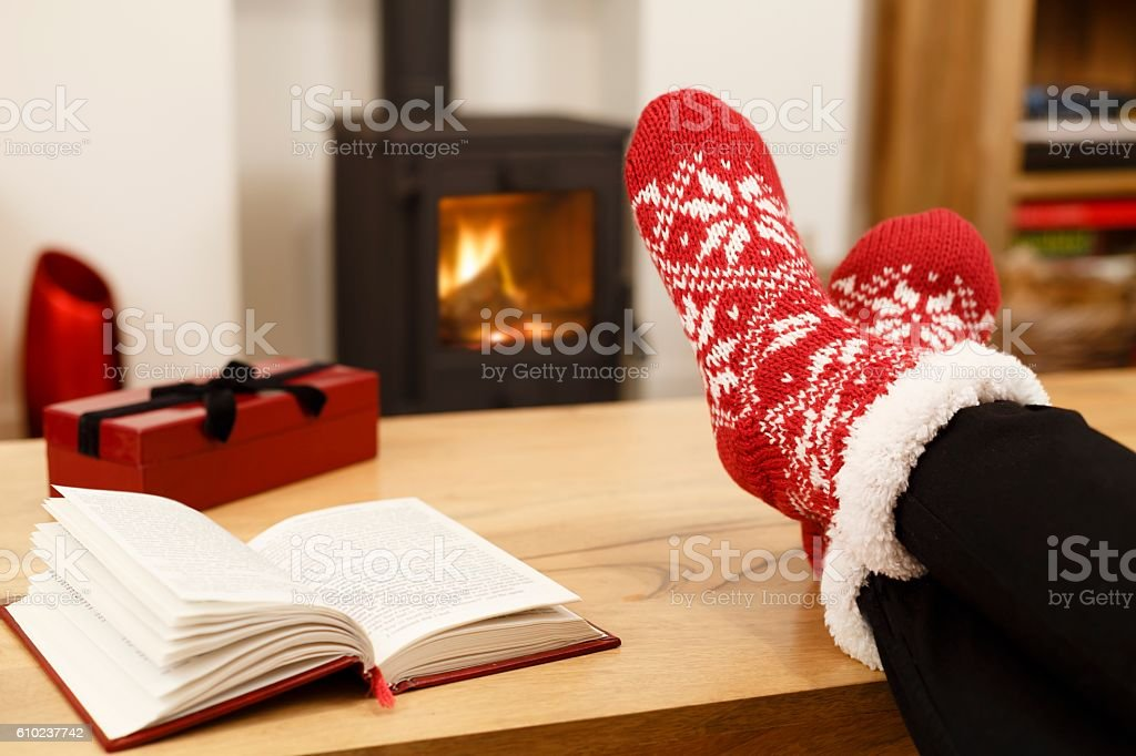 Cosy Christmas in front of wood burner stock photo
