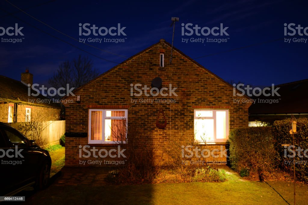 Cosy Cottage at Night stock photo