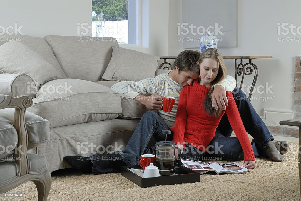 Cosy couple relaxing with magazine royalty-free stock photo