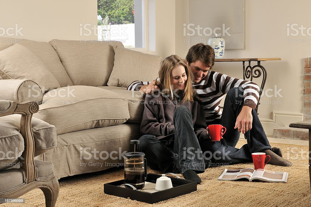 Cosy couple with red coffee mugs royalty-free stock photo