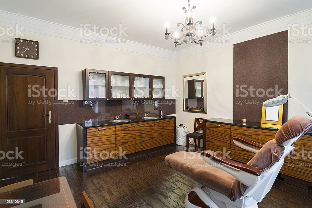 Cosy surgical beauty salon interior, dermatological clinic with armchair, brown royalty-free stock photo
