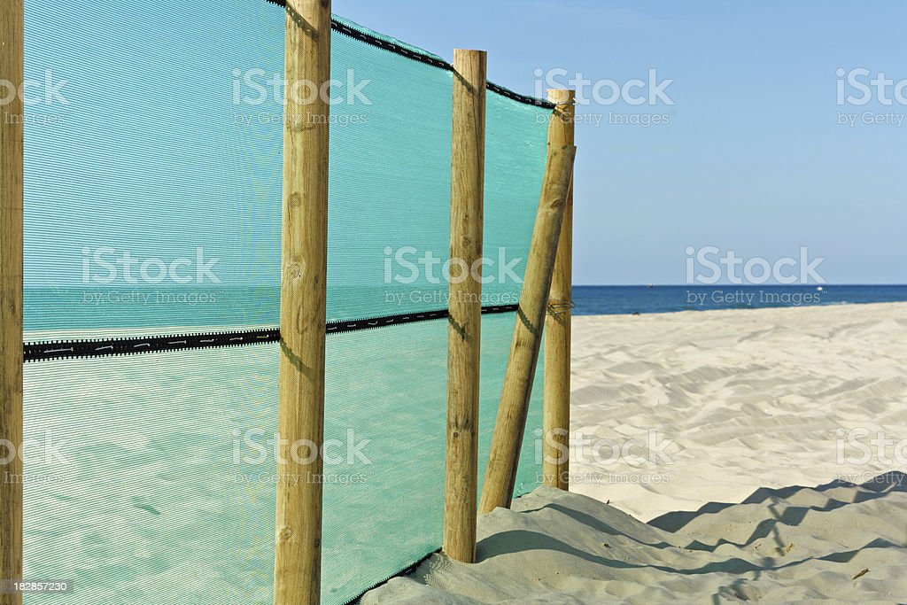 Cote d'Argent - Fence on the beach stock photo