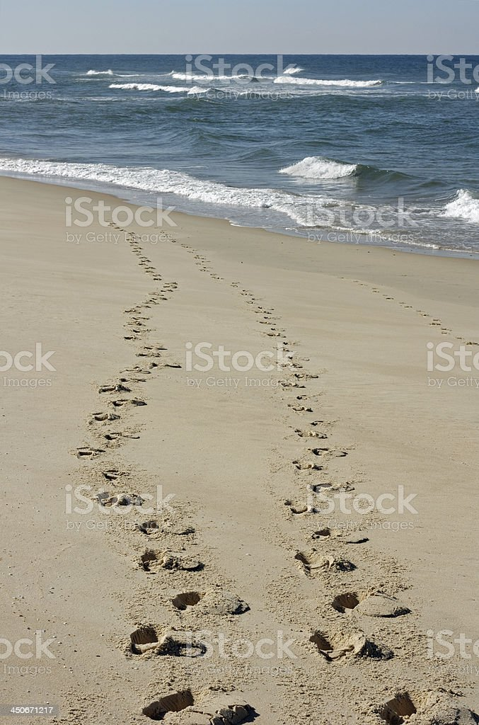 Cote d'Argent - Footsteps on the beach stock photo