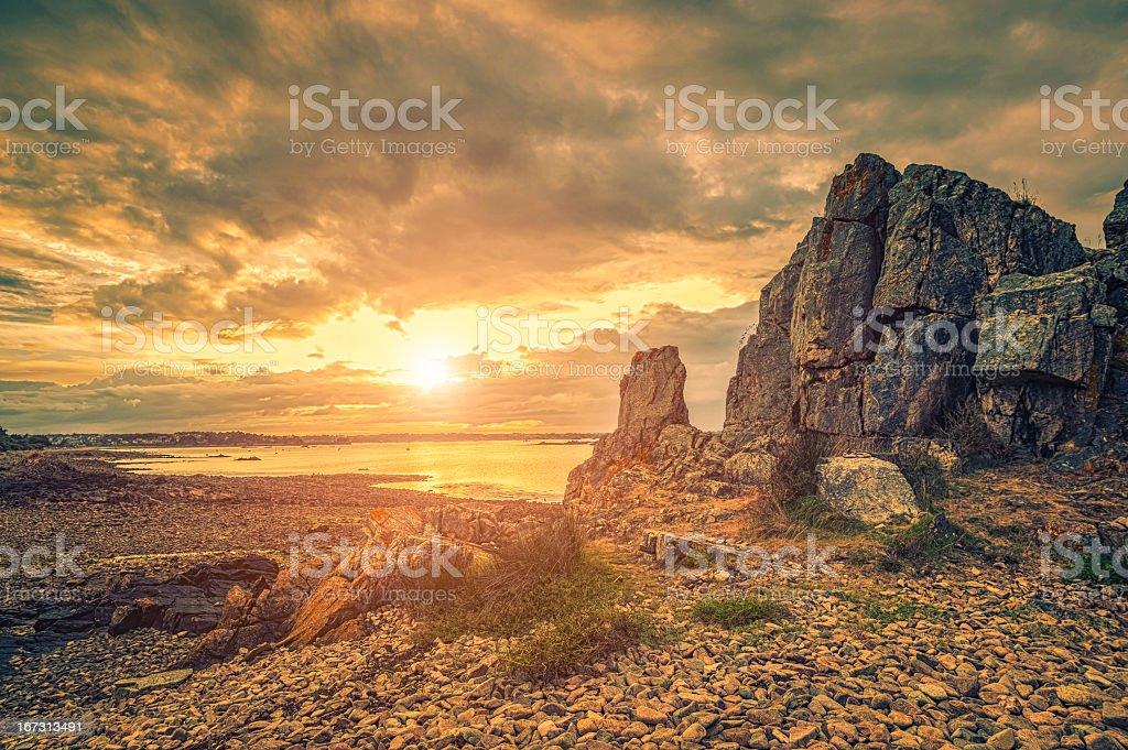 Cote de Granite Rose in Bretagne at sunset stock photo