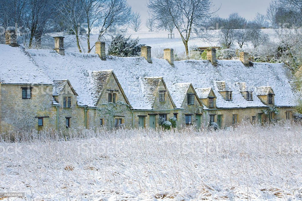 Cotswold cottages dusted with January Snow stock photo