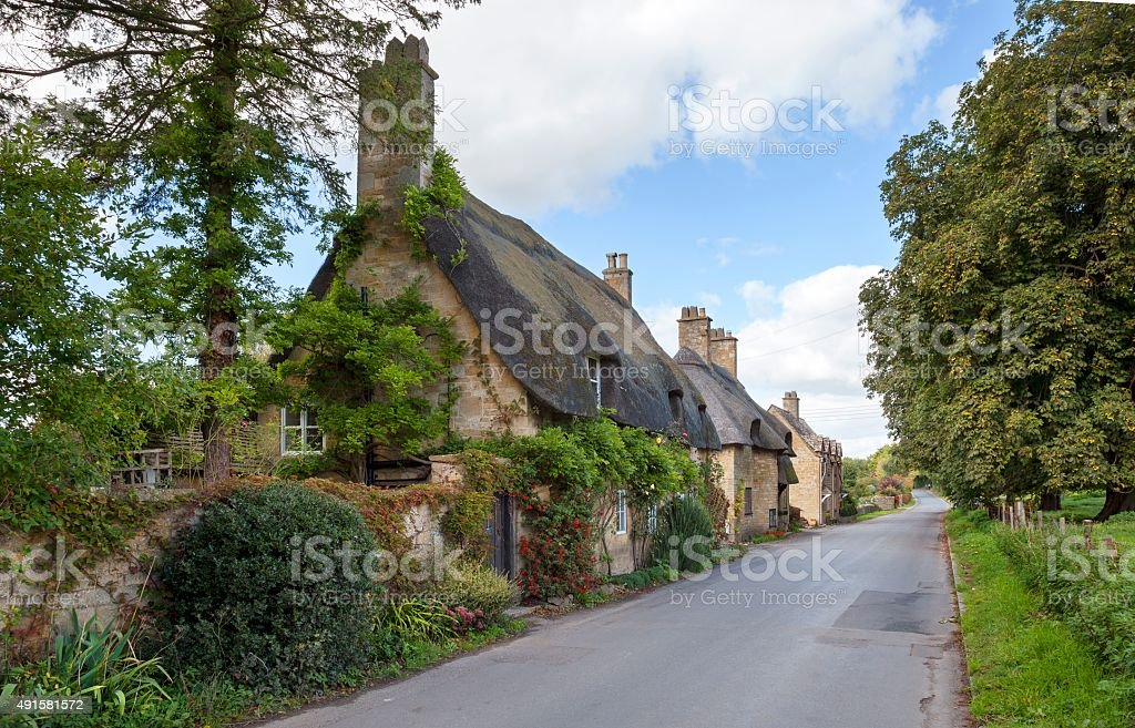 Cotswold thatched cottages, England stock photo