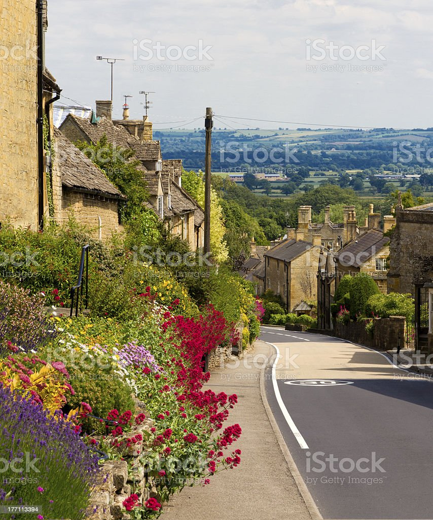Cotswolds village Bourton-on-the-Hill with flowers, UK stock photo