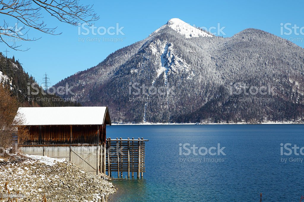 cottage at lake Walchensee in Bavaria Germany covered in snow stock photo
