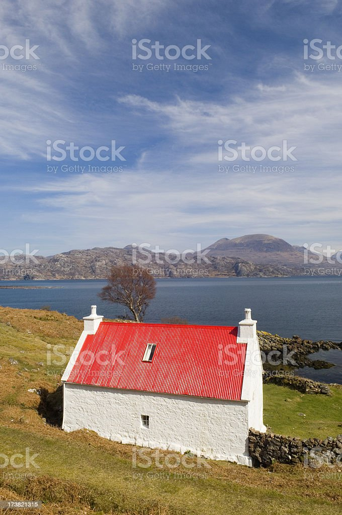 Cottage by the sea stock photo