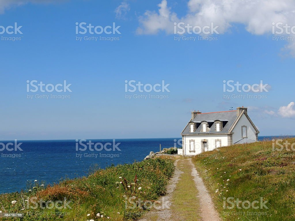 Cottage by the sea... stock photo