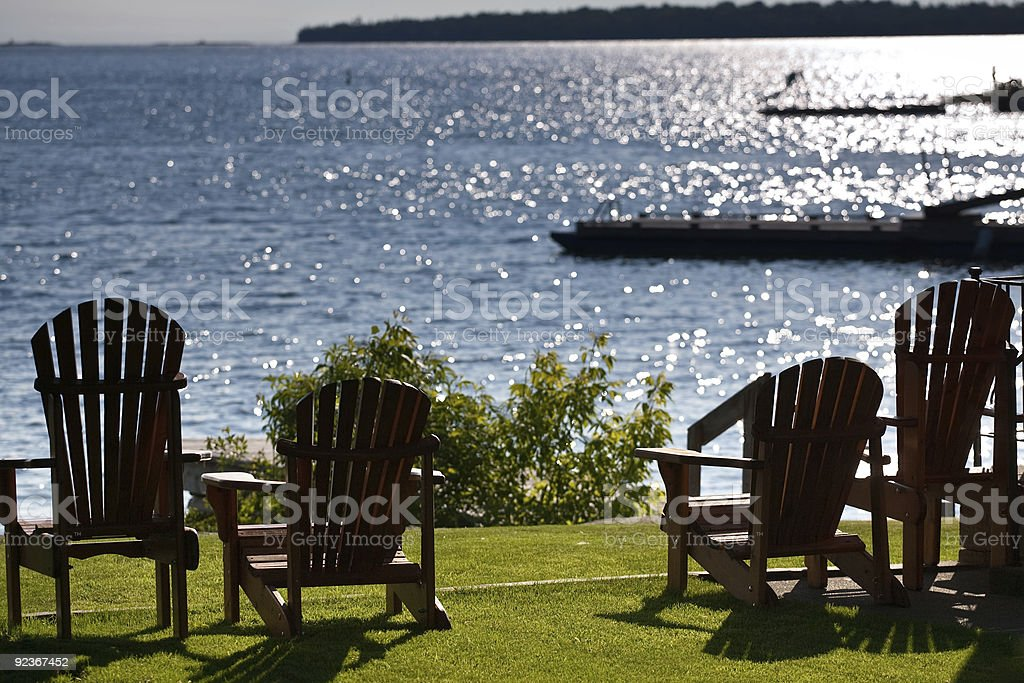 Cottage chairs facing the lake stock photo