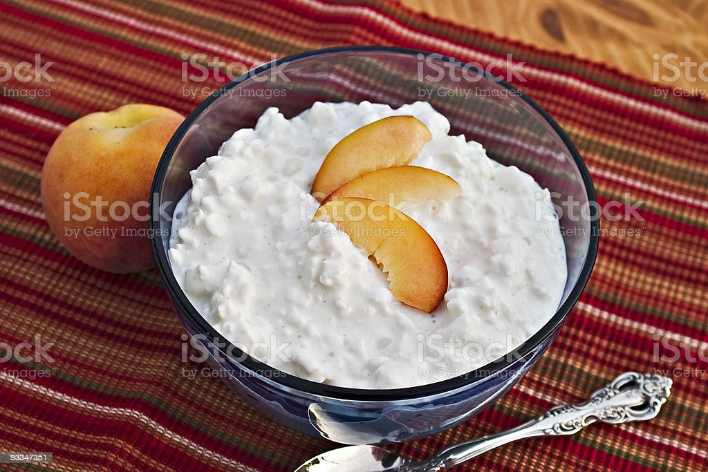 Cottage cheese and fresh fruit stock photo
