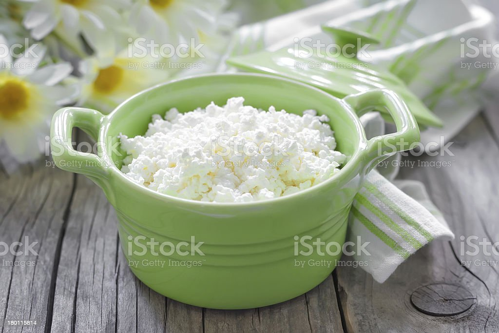 Cottage cheese in a green dish stock photo