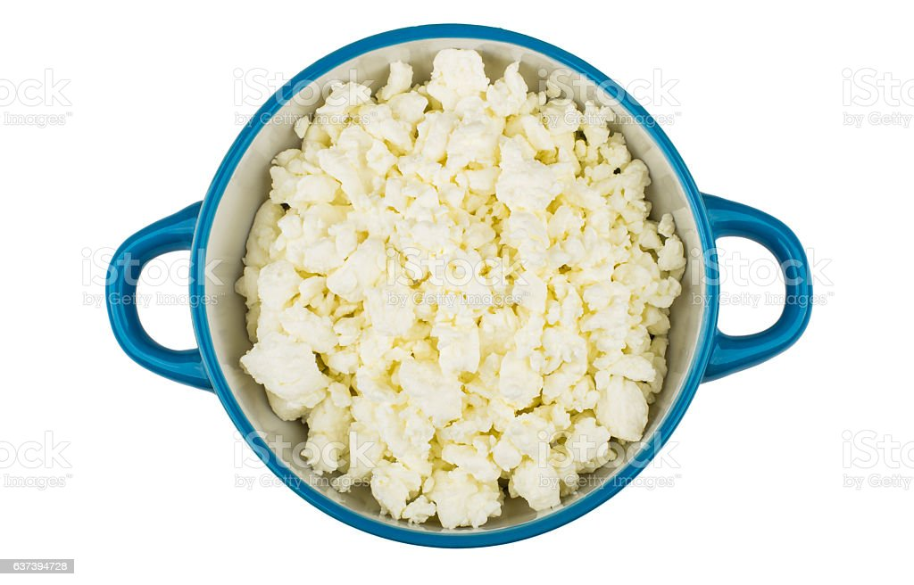 Cottage cheese in blue bowl isolated on white background stock photo