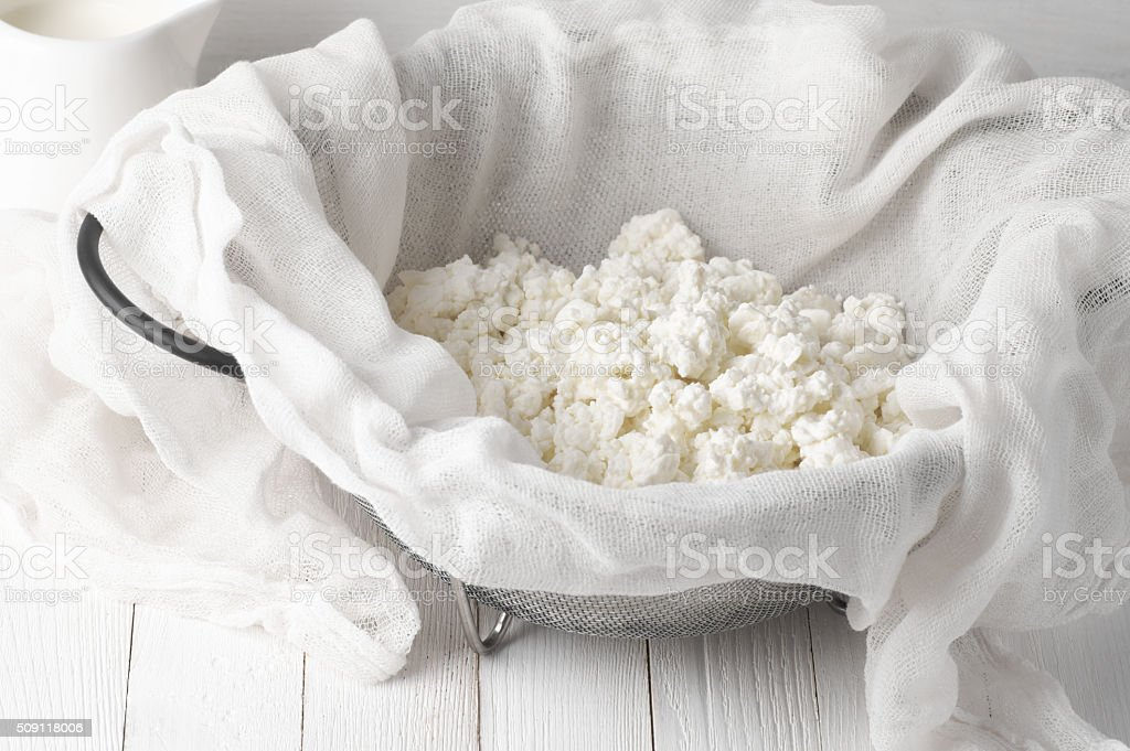 Cottage cheese in cheesecloth stock photo