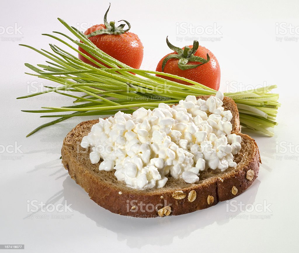 Cottage cheese on a slice of bread stock photo