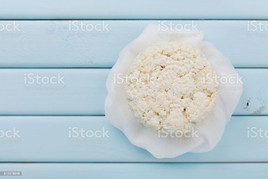Cottage cheese or ricotta on light blue table, copy space stock photo