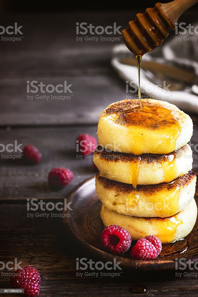 Cottage cheese pancakes on wooden table. stock photo