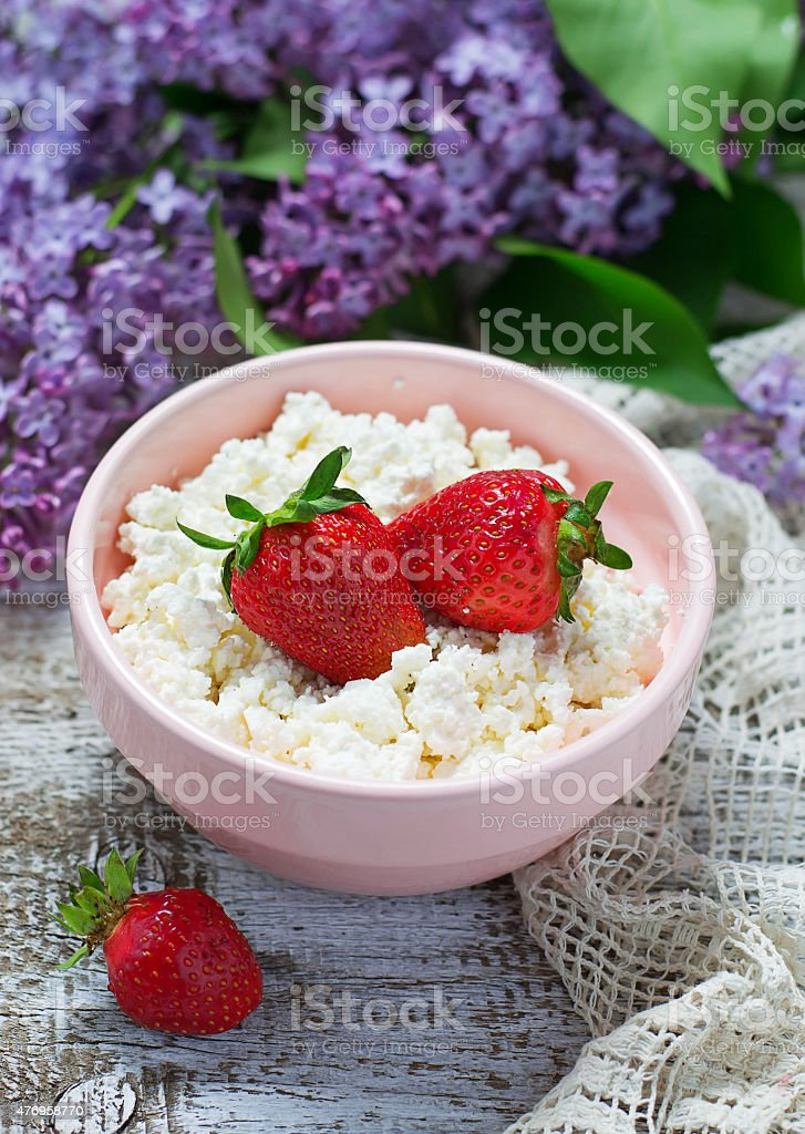 Cottage cheese with fresh strawberries stock photo