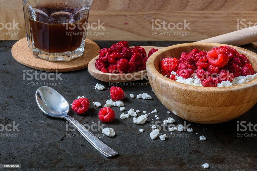 Cottage cheese with raspberries and cup of coffee for breakfast stock photo