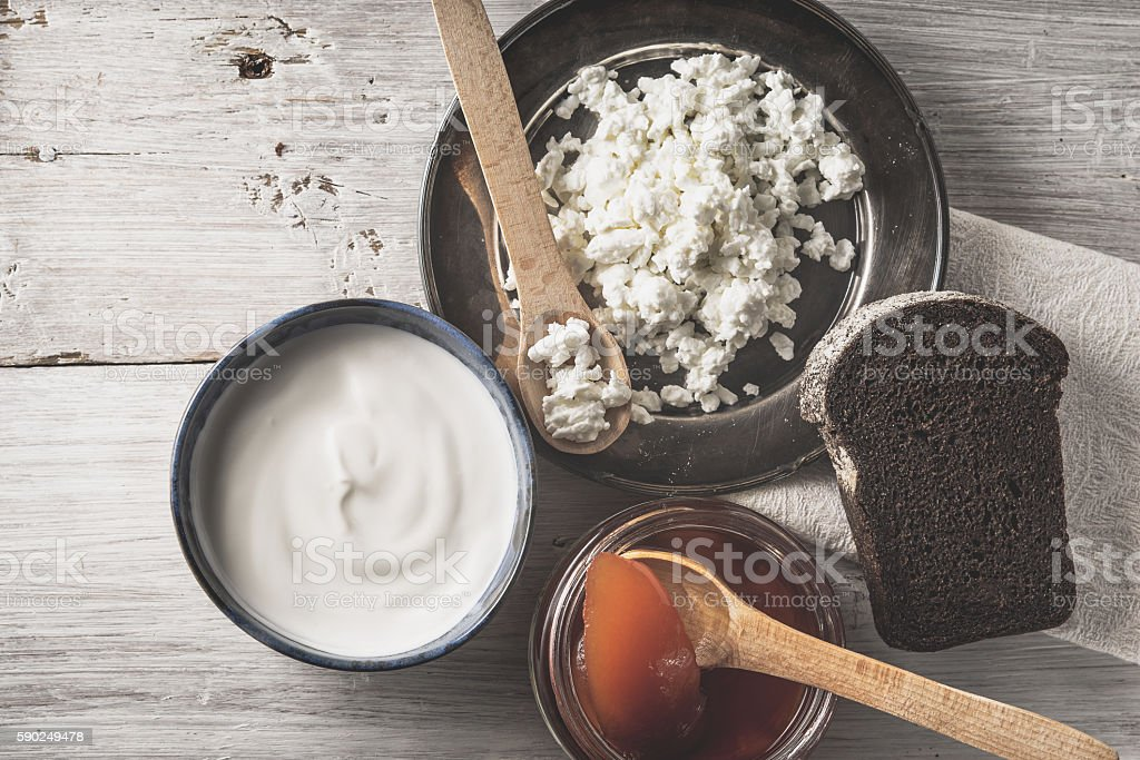 Cottage cheese with sour cream, jam and bread  top view stock photo