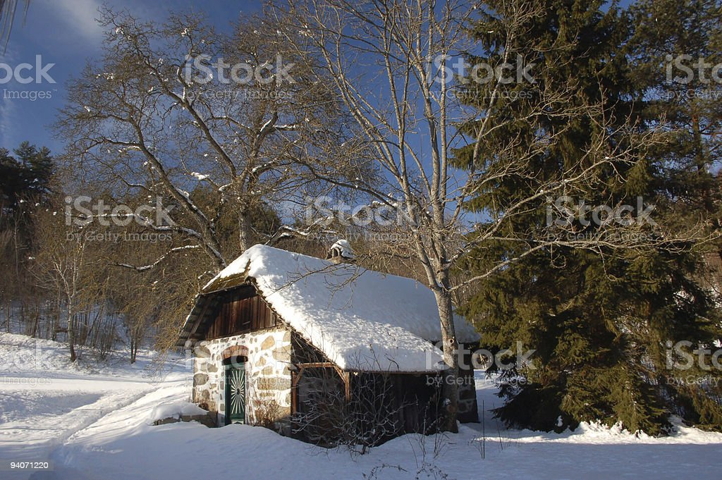Cottage in Winter Forest stock photo