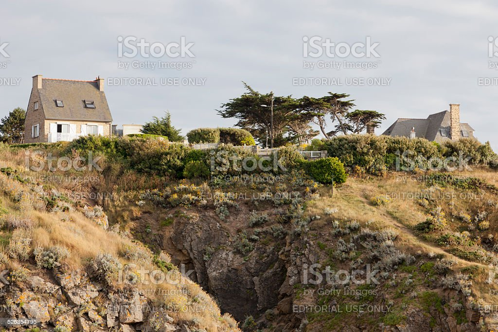 Cottage on cliffs in Brittany stock photo