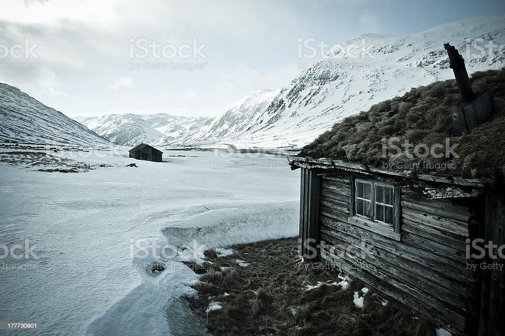 Cottage on the ice desert in Norway stock photo