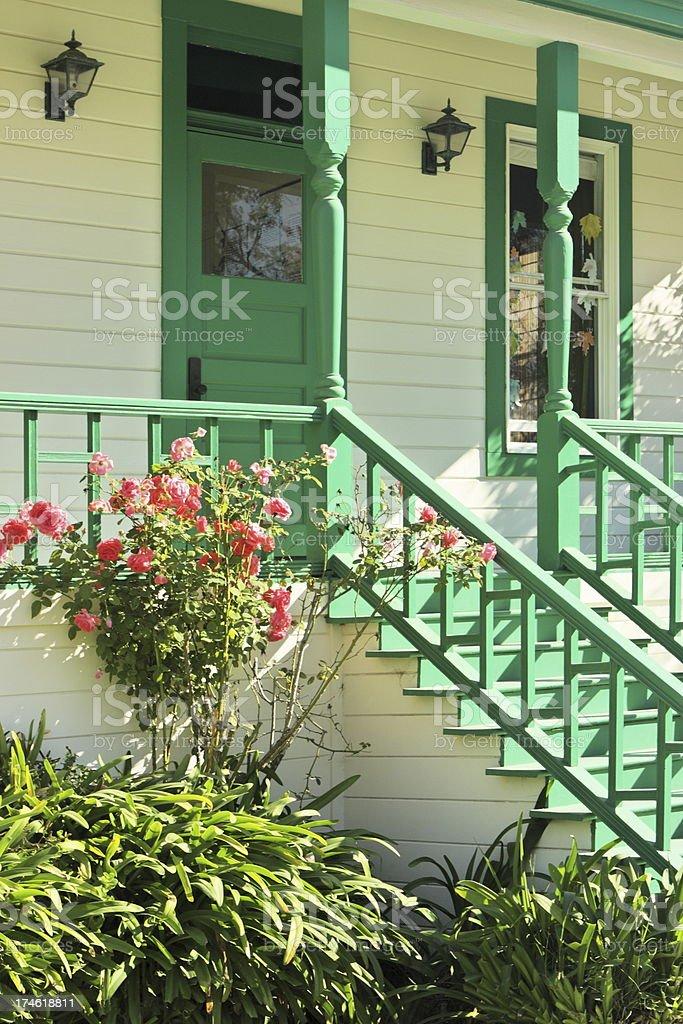 Cottage Porch Railing Steps Clapboard Siding royalty-free stock photo