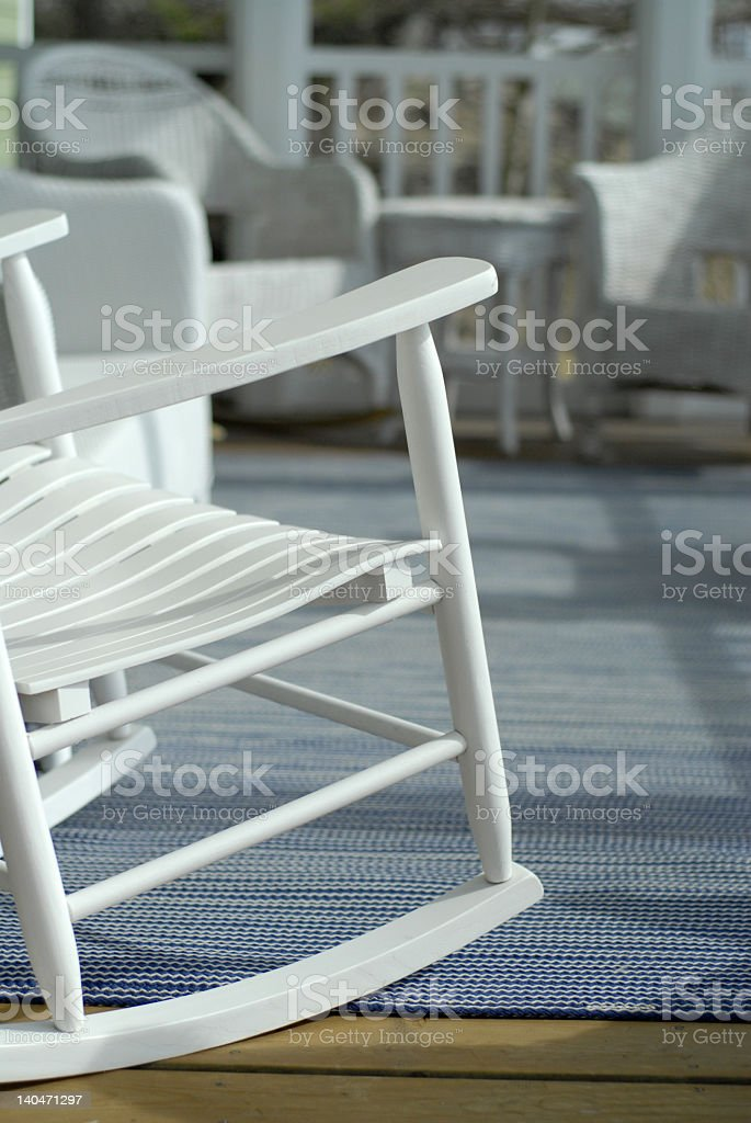 A cottage porch with decking and seats stock photo