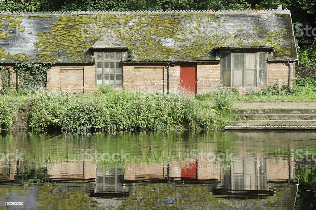 Cottage reflected in a river stock photo