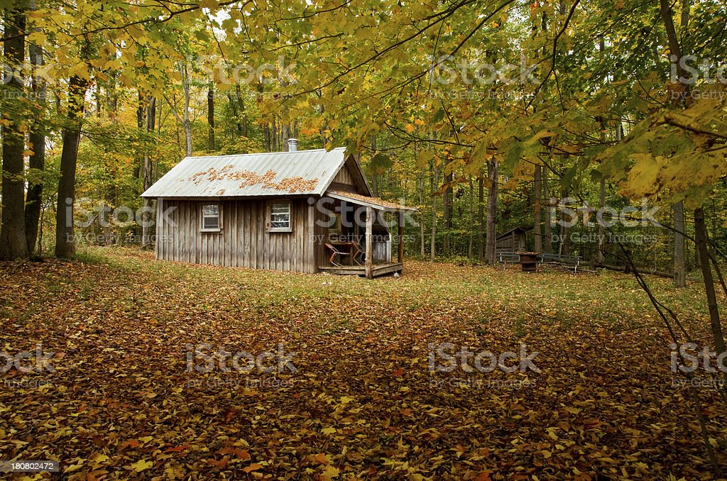 cottage with fall trees royalty-free stock photo