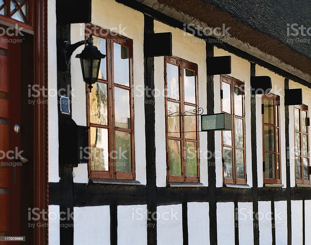 Cottage with Window Mirror stock photo