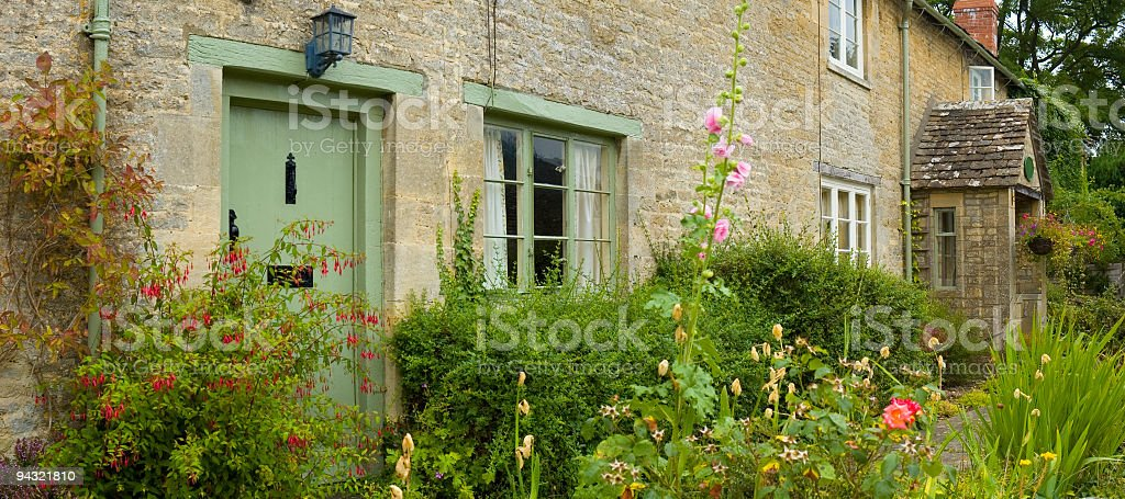 Cottages and flowers stock photo