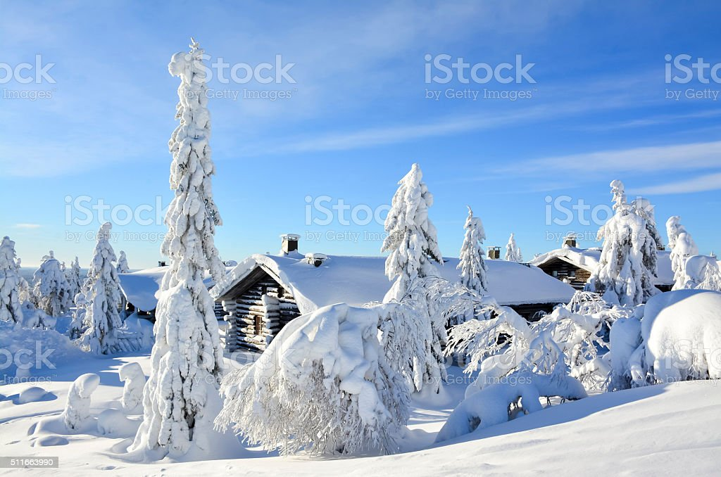 Cottages on snowy mountain on a sunny winter day stock photo