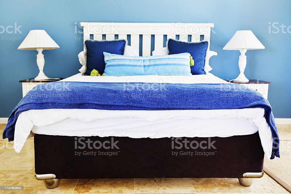 Cottage-style modern double bedroom in blues and white royalty-free stock photo