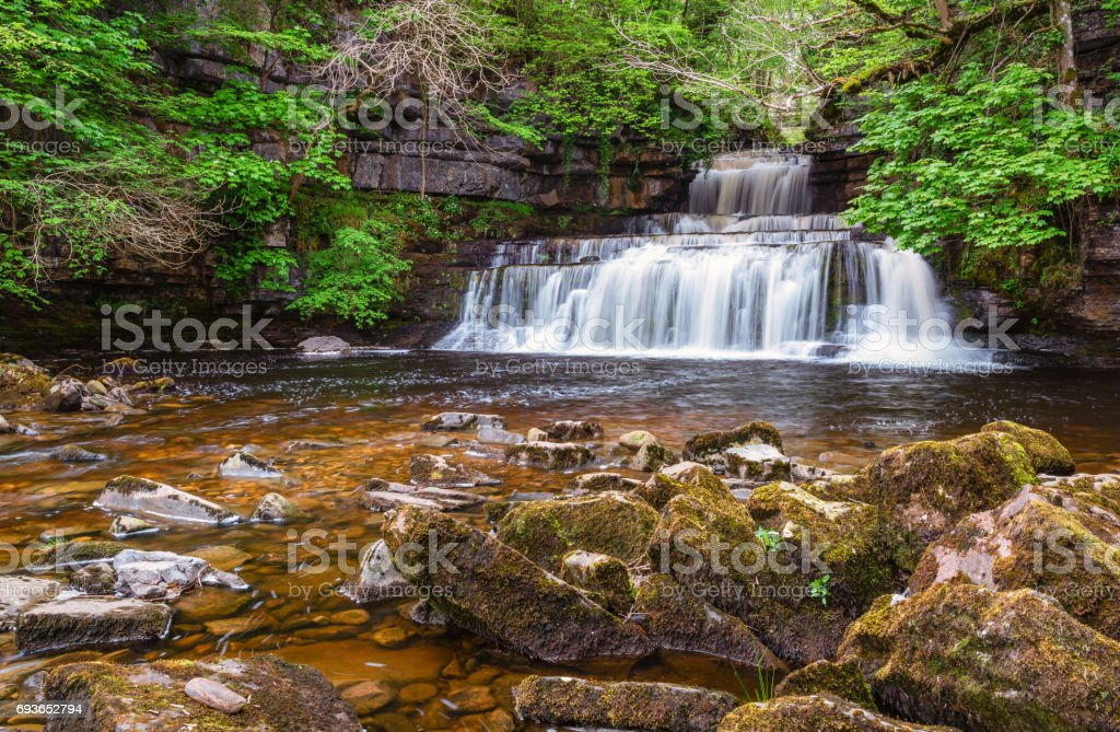 Cotterdale Beck flows over Cotter Force stock photo