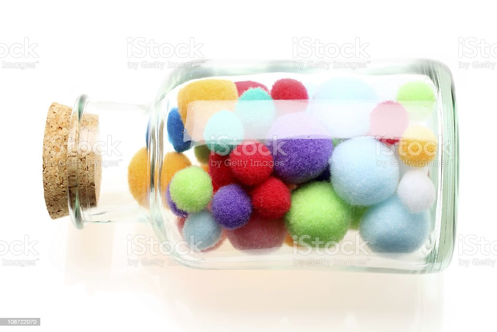 Cotton balls in a bottle stock photo