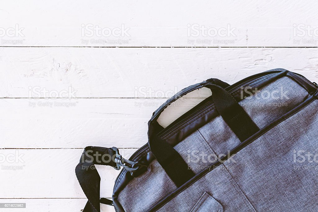 Cotton brown bag on wooden background stock photo