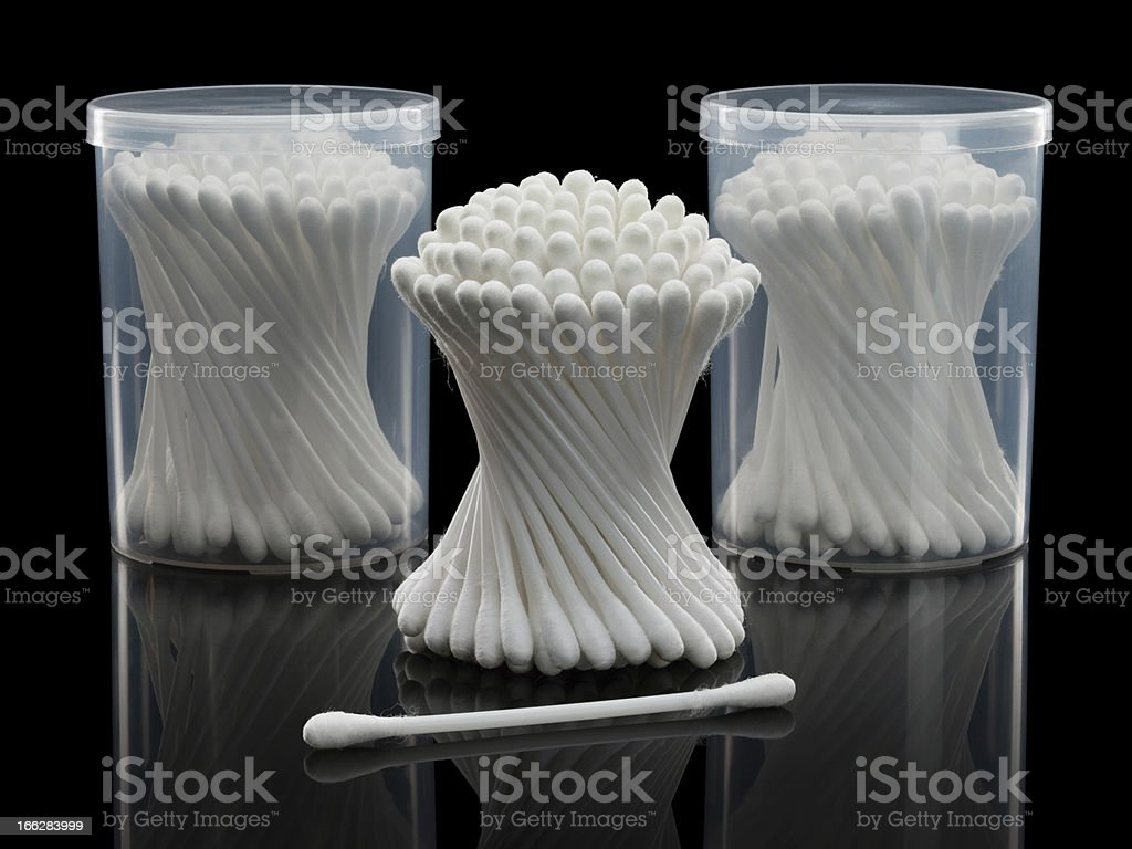 Cotton buds and plastic packing on a black background royalty-free stock photo
