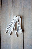Cotton buds isolated on wooden background