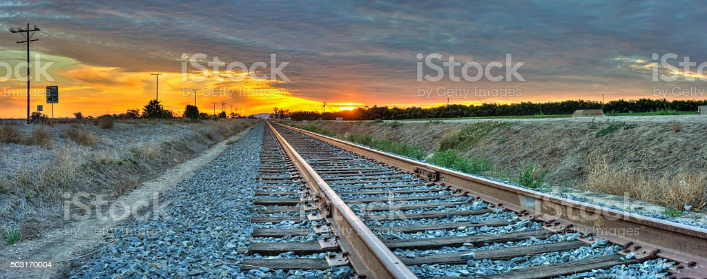Cotton candy clouds on right track stock photo