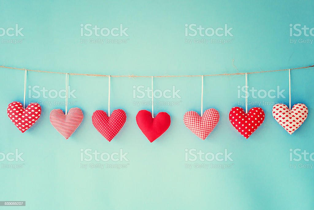 Vintage cotton hearts hanging from a clothesline
